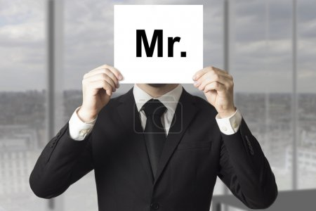 businessman hiding face sign mister