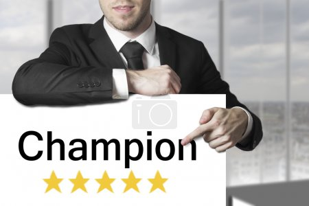 Businessman pointing on sign champion golden star rating