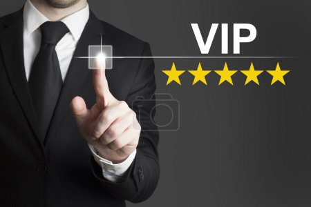 businessman pushing button vip five stars