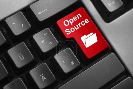 Photo pour Dark grey keyboard red button open source - image libre de droit