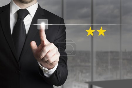 Businessman pushing button two star rating