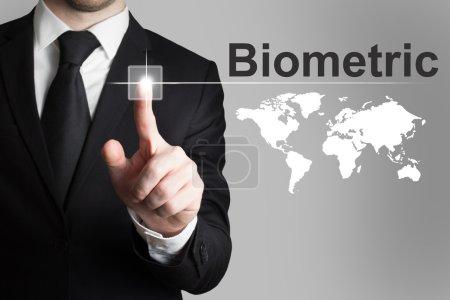 Businessman pushing button biometric worldmap