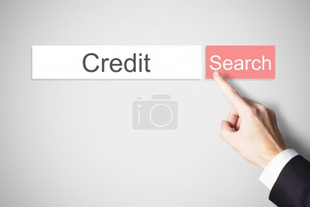 Photo pour Doigt d'homme d'affaires en poussant le crédit de bouton recherche web rouge - image libre de droit