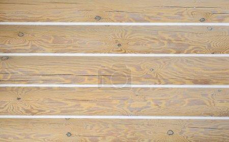 Photo pour Coulis de joints sur une cabane en rondins. fond en bois avec une texture en bois naturel - image libre de droit