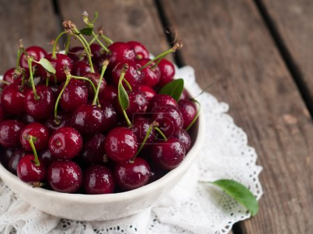 Ripe cherries in rustic bowl