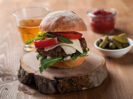 Photo for Homemade hamburger with fresh tomatoes, selective focus - Royalty Free Image