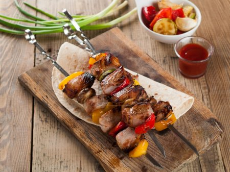 Photo for Grilled meat and vegetable kebabs with sauce, selective focus - Royalty Free Image