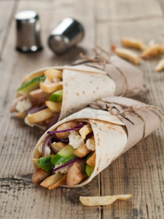 Photo for Fresh tortilla wraps with grilled chicken,vegetables and potato, selective focus - Royalty Free Image
