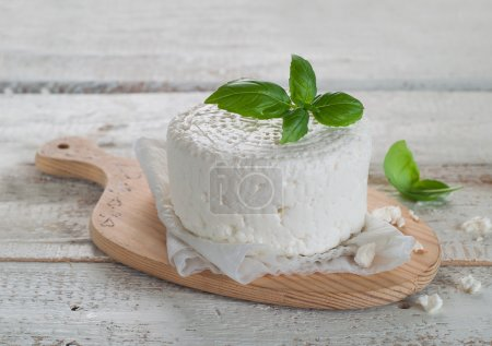Photo for Fresh cheese with basil, selective focus - Royalty Free Image