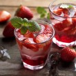 Summer drink with strawberry in glasses on the vin...