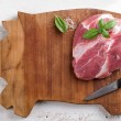 Raw fresh meat on wooden board, selective focus...