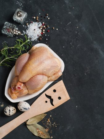 Photo for Fresh chicken on dark vintage background, selective focus. Healthy food, diet or cooking concept - Royalty Free Image