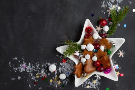 Photo for Gingerbread cookies and candy in Christmas setting, selective focus - Royalty Free Image