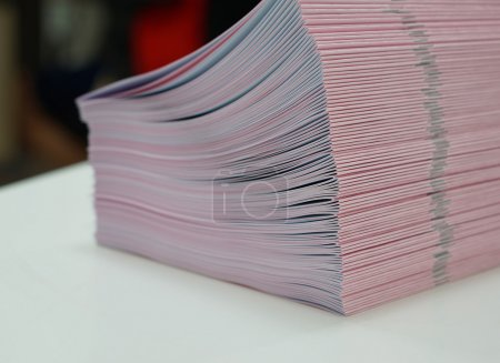 Piles of handout papers placed on table