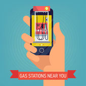 Gas station near you Hand with mobile device with gas filling stations search application