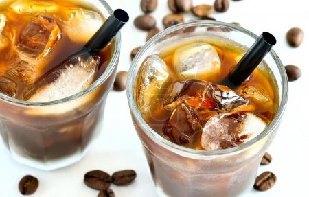 Photo for Iced coffee in two glasses with black straws and coffee beans on the backstage - Royalty Free Image