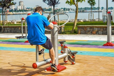 Man working out on working equipment outdoors