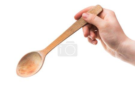 Photo pour Une image de femme cuillère de bois tenant dans la main - image libre de droit