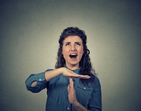 woman showing time out hand gesture, frustrated screaming to stop