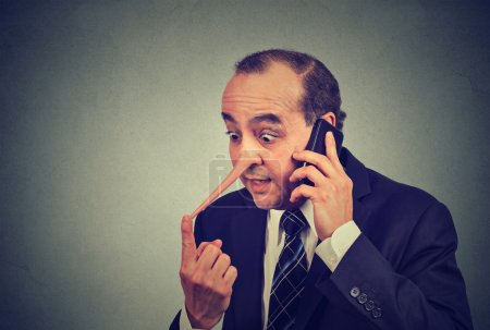 Liar customer service representative. Man with long nose talking on mobile phone lying