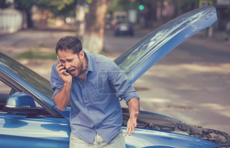 Photo for Young frustrated angry man calling for car service screaming standing by broken car. Rude customer service bad road car assistance - Royalty Free Image