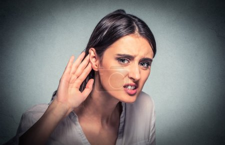 nosy woman hand to ear carefully listens in on gossip conversation. Hard to hea