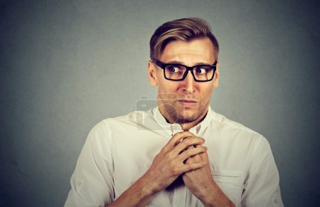 Photo for Nervous stressed young man student feels awkward looking away sideway anxiously craving something isolated gray wall background. Human emotion face expression feeling body language - Royalty Free Image