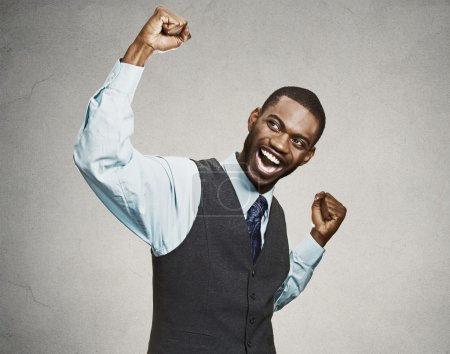Successful business man celebrates victory