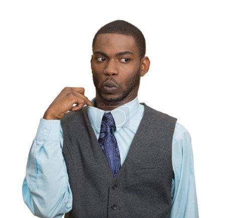 Closeup portrait, young business man opening shirt...