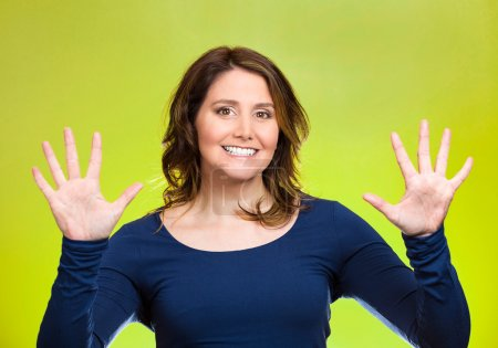 Woman making two times five sign gesture with hands, fingers, number ten