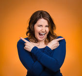 Woman pointing in two different directions, stressed, frustrated