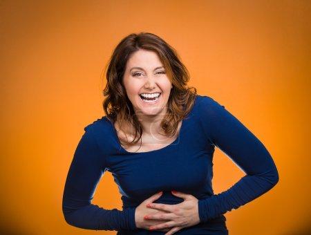 Laughing woman hearing good news, joke