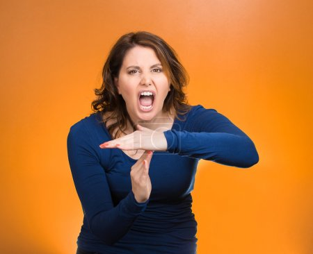 Screaming woman, showing time out gesture with hands
