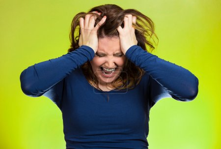 Photo for Closeup portrait stressed business woman, pulling her hair out, yelling, screaming with temper tantrum isolated green background. Negative human emotions, facial expressions, reaction attitude - Royalty Free Image