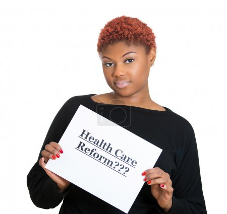 Confused, skeptical woman holding sign, health care reform