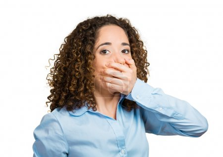 Woman covering mouth. Speak no evil concept