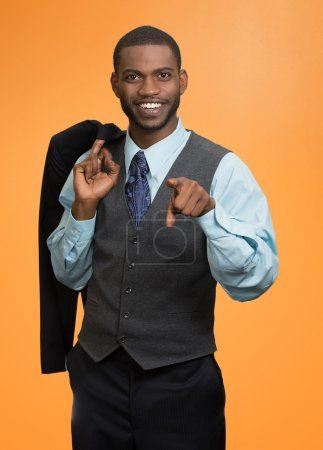 Portrait cheerful young man in full suit, pointing finger at you