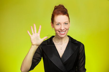 Young woman making five times sign gesture with hand fingers