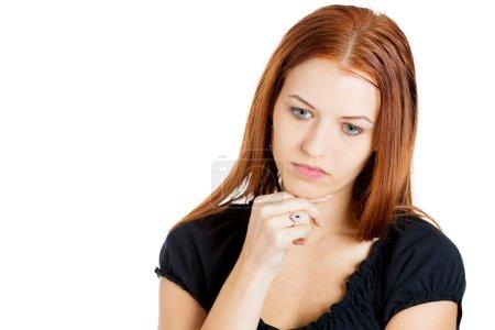 Gloomy woman stressed, tired, looking down, depressed