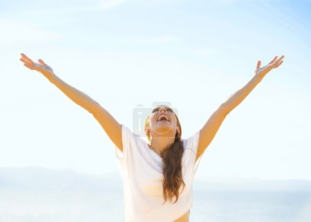 Photo for Woman smiling arms raised up to blue sky, celebrating freedom. Positive human emotions, face expression feeling life perception success, peace of mind concept. Free Happy girl on beach enjoying nature - Royalty Free Image