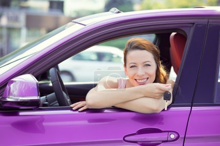 Photo for Closeup portrait happy, smiling, young attractive woman, buyer sitting in her new blue car showing keys isolated outside dealer, dealership lot, office. Personal transportation, auto purchase concept - Royalty Free Image