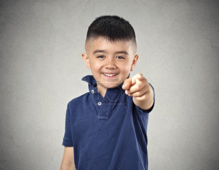 Photo for Laughter. Portrait boy laughing pointing finger at someone something, at camera gesture isolated grey wall background. Positive human face expression emotion feeling attitude life situation perception - Royalty Free Image