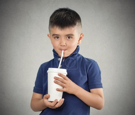 Child drinking with a straw