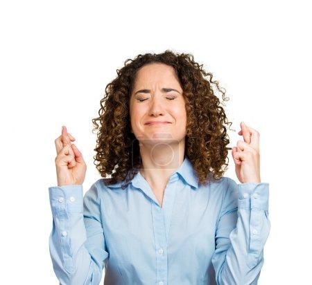 Woman crossing fingers