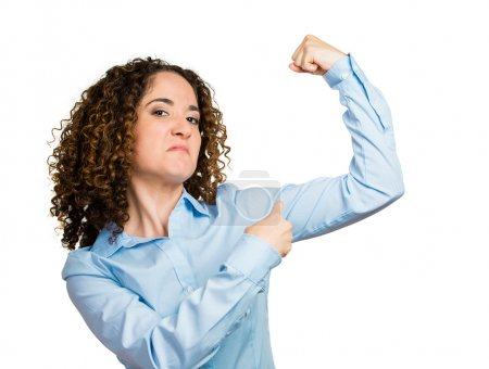 Woman flexing muscles showing her strength