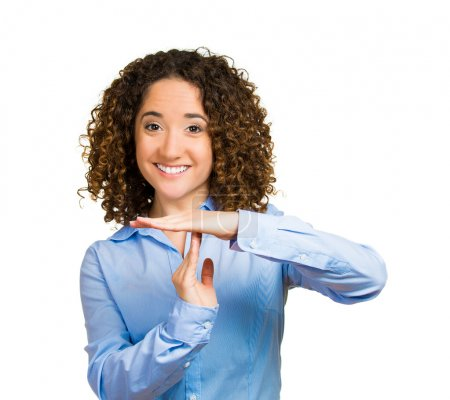 Smiling woman showing time out gesture