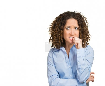 Photo for Closeup portrait nervous looking woman biting her fingernails craving something anxious isolated on white background. Negative human emotion facial expression body language perception - Royalty Free Image