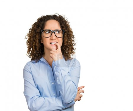 Photo for Closeup portrait nervous woman with glasses biting her fingernails craving for something, anxious, isolated white background with copy space. Negative human emotions, facial expressions, body language - Royalty Free Image