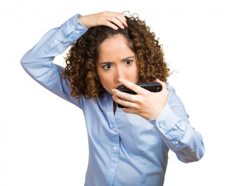 Shocked young woman, feeling head, surprised she is losing hair