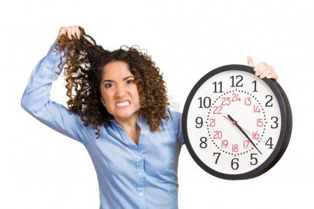 Woman, worker, holding clock looking anxiously